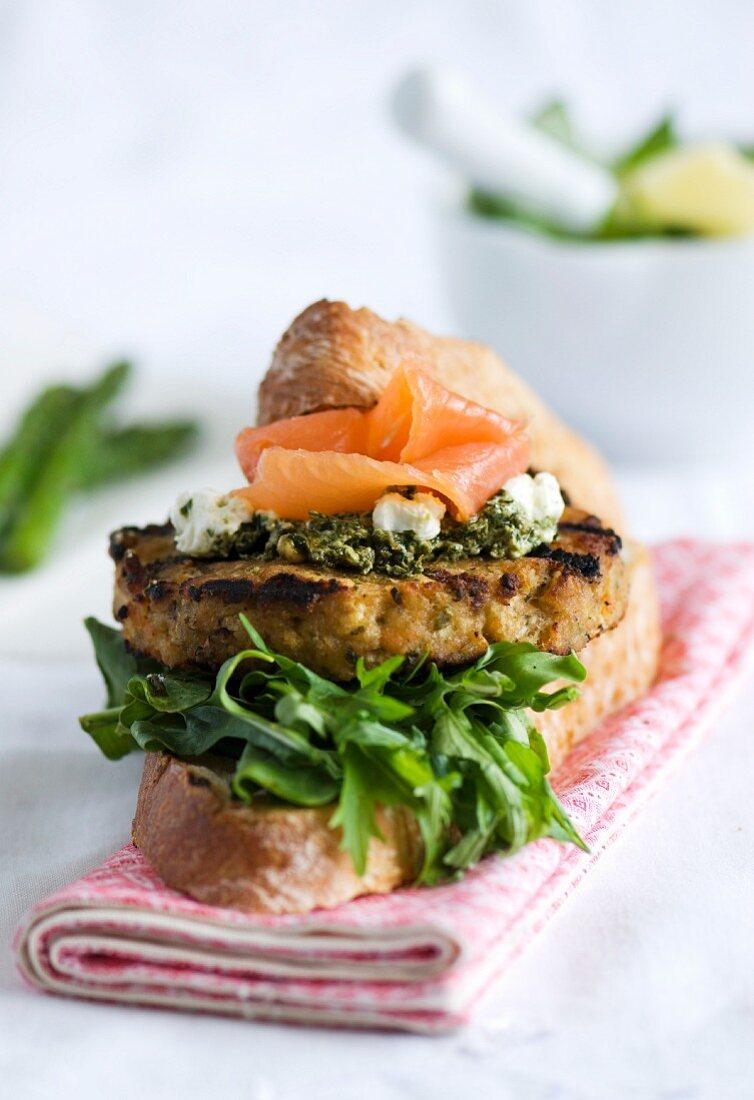 Salmon burger with pesto and rocket