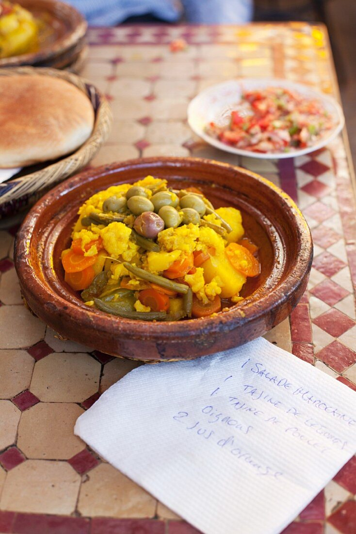 Bowl of tagine on restaurant table