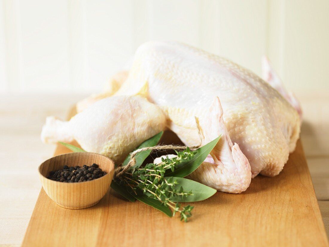 Whole, Uncooked Roasting Chicken with Bouquet Garni and Black Peppercorns