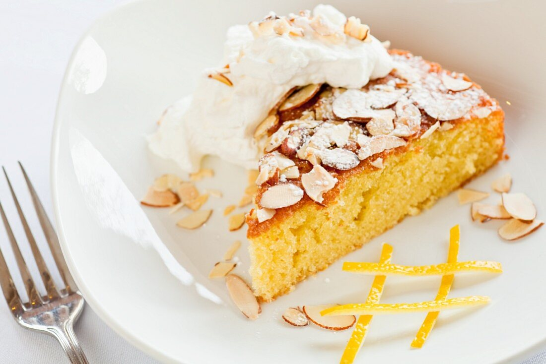 Citrus Olive Oil Cake Topped with Almonds and Whipped Cream