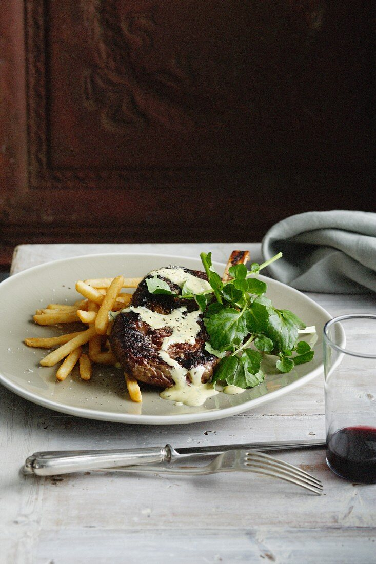 Plate of steak with fries and salad