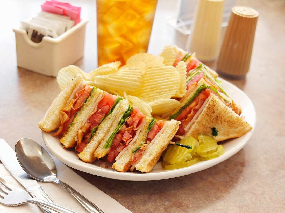 A Turkey Club with Potato Chips at a Diner