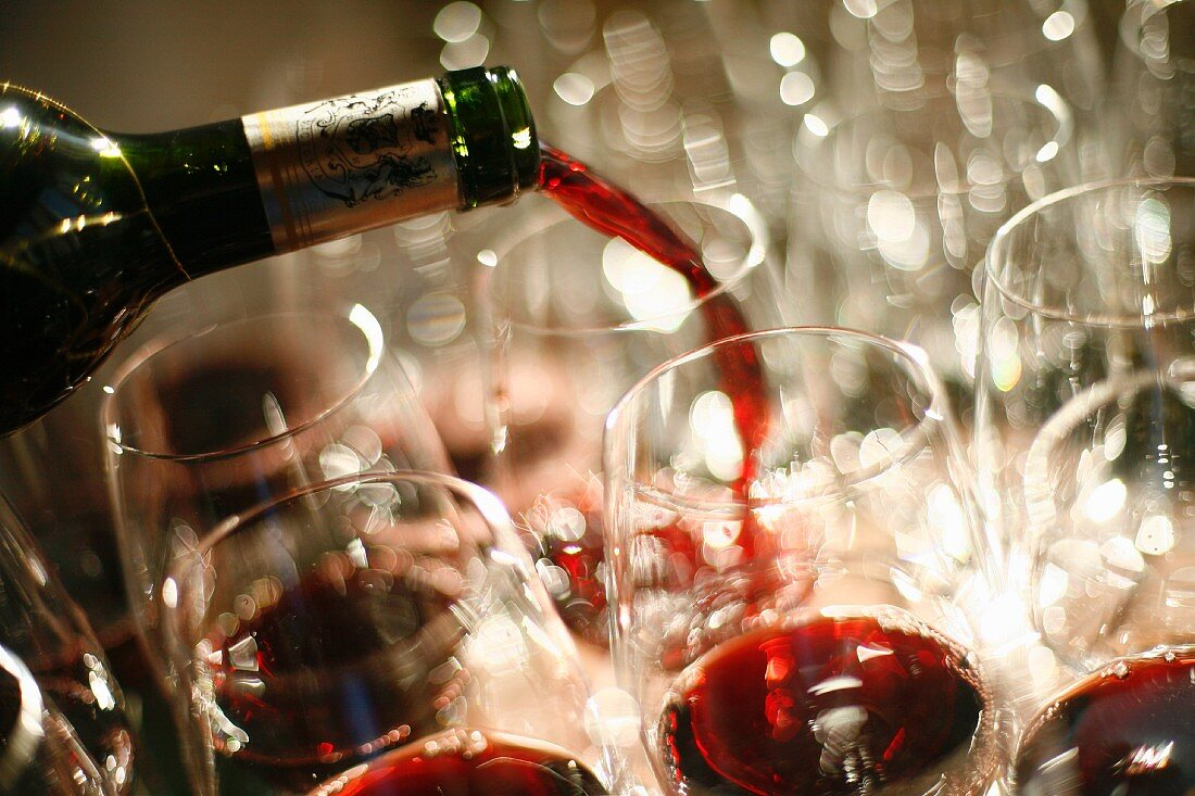 Red Wine Pouring into Glasses at a Wine Tasting