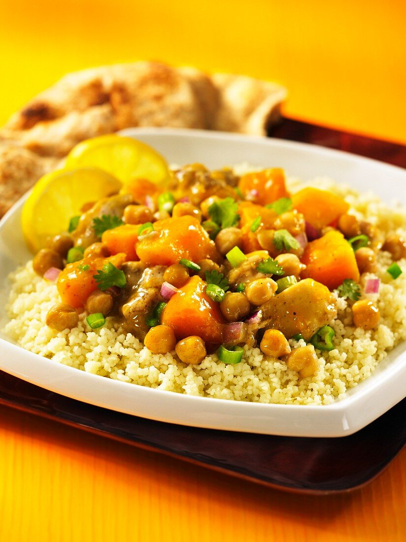 North African chicken ragout with chickpeas and sweet potatoes on a bed of couscous