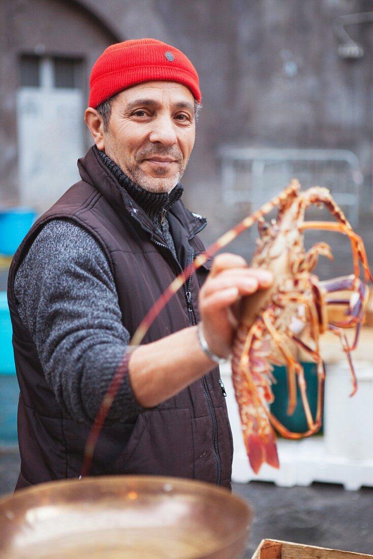 fisherman presenting lobster