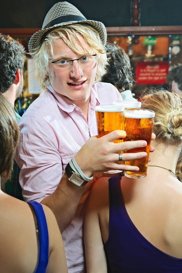 Man holding glasses of beer