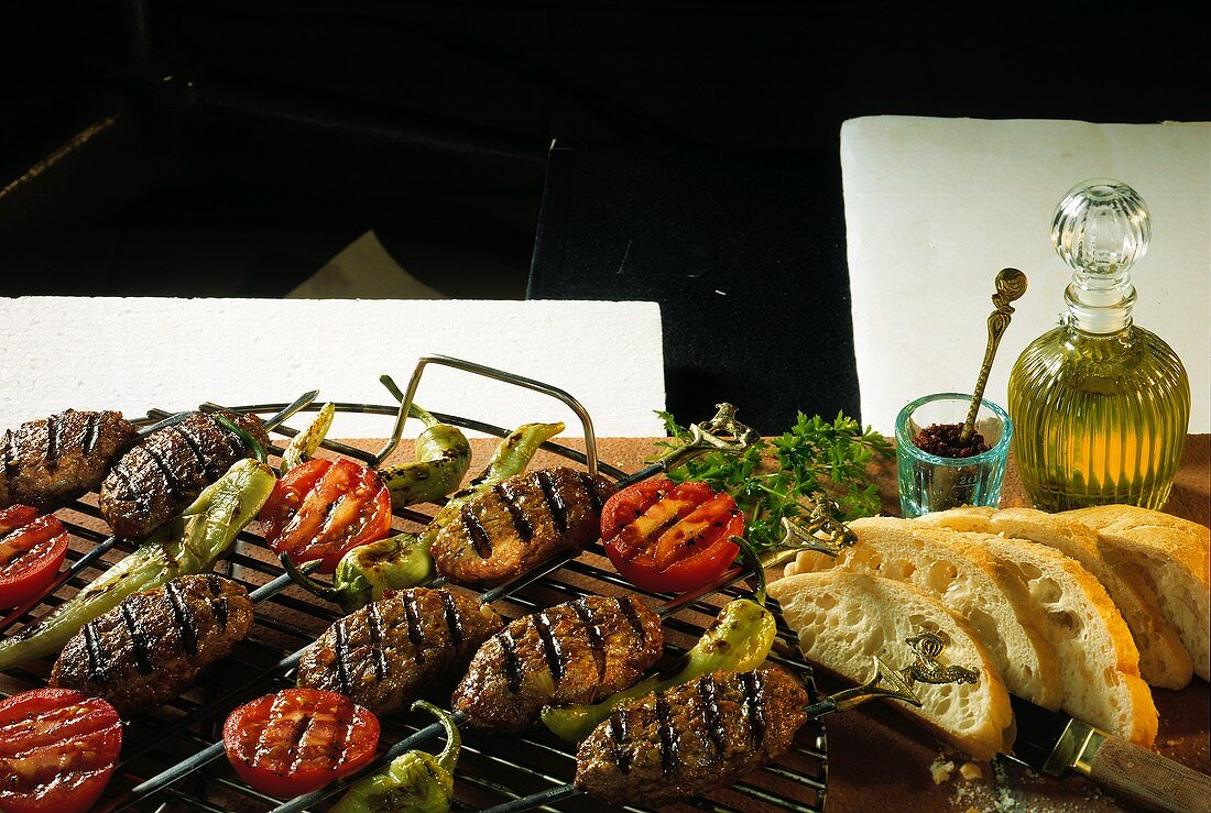 Adana kebabs with tomato slices; grilled pepperoni