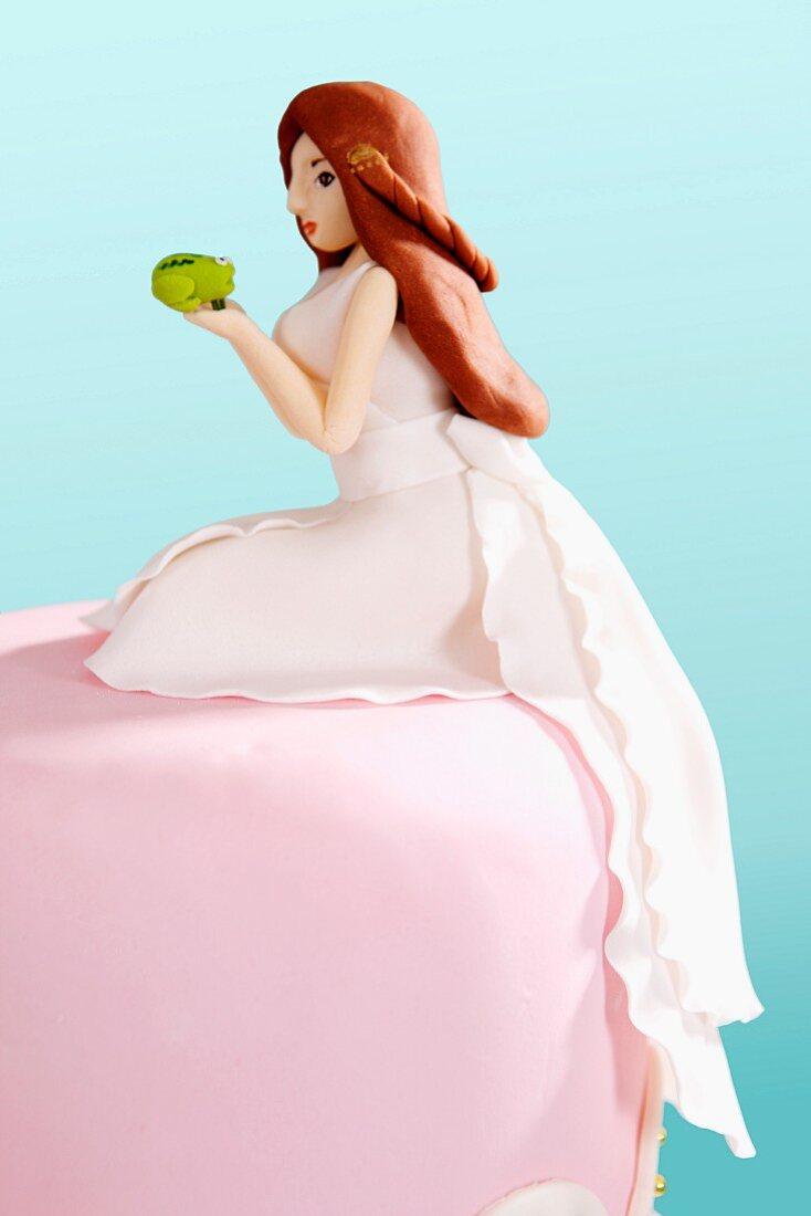 A wedding cake decorated with a fondant princess