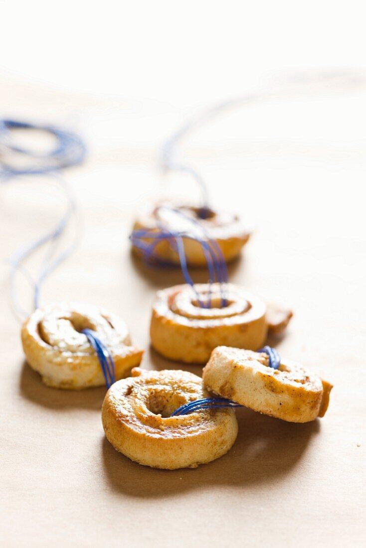 Almond buns on a blue thread