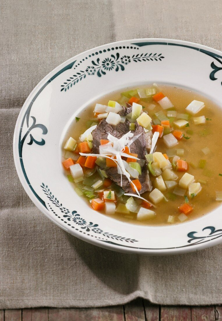Prime boiled beef in a vegetable broth