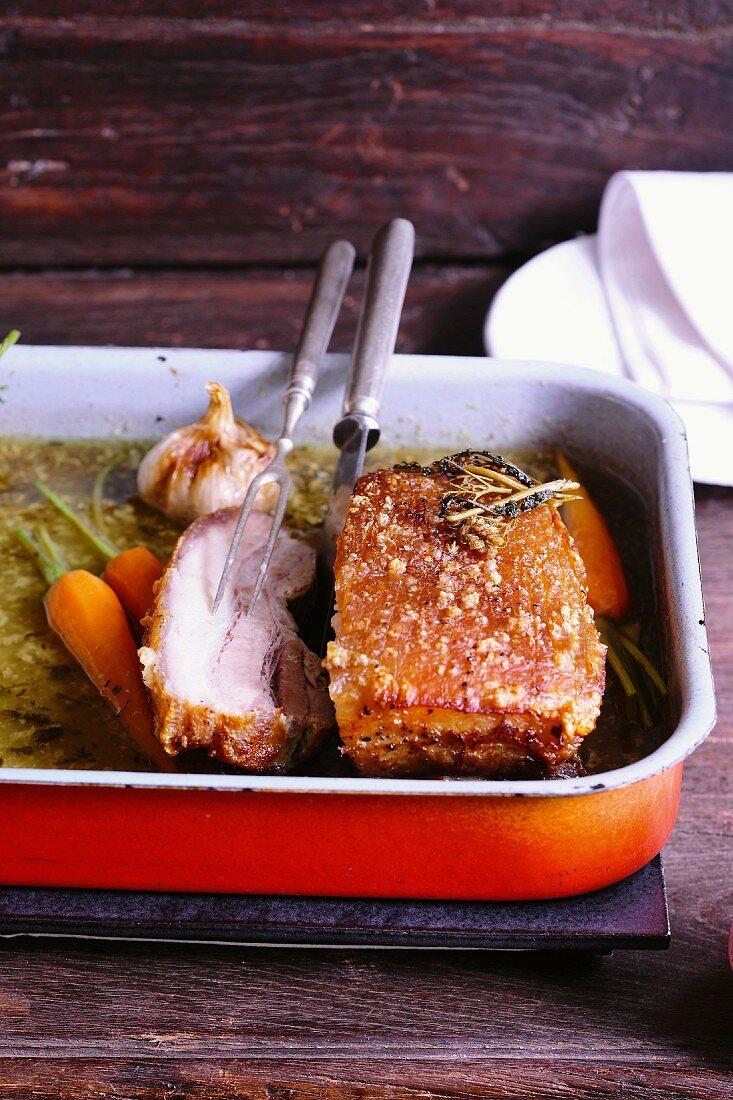 Crispy roast pork braised in yarrow tea