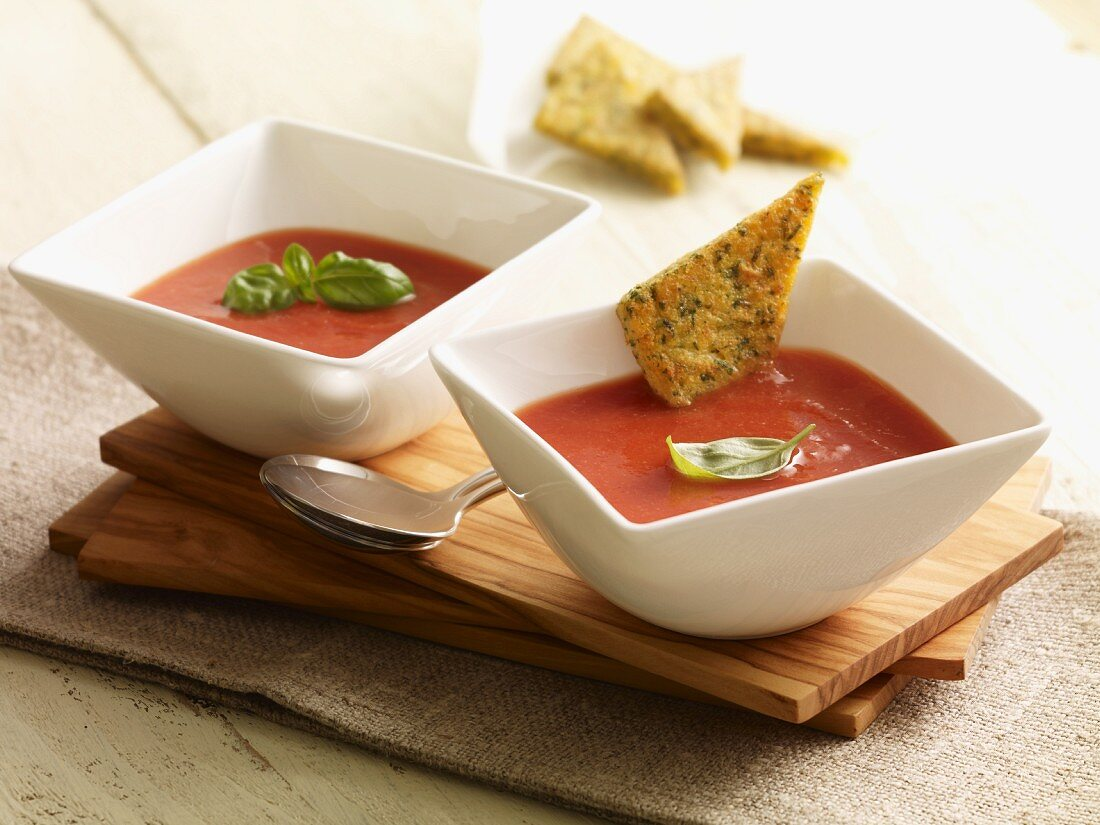 Cream of tomato soup with herb and polenta triangles