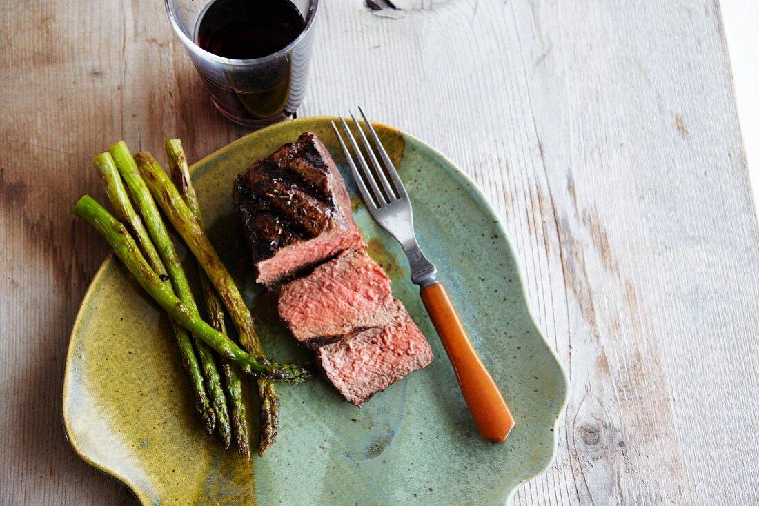 Buffalo Strip Steak with Asparagus; Fork and Wine