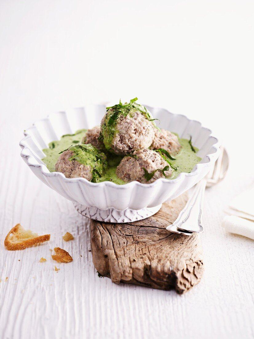 Königsberg dumplings with herb sauce