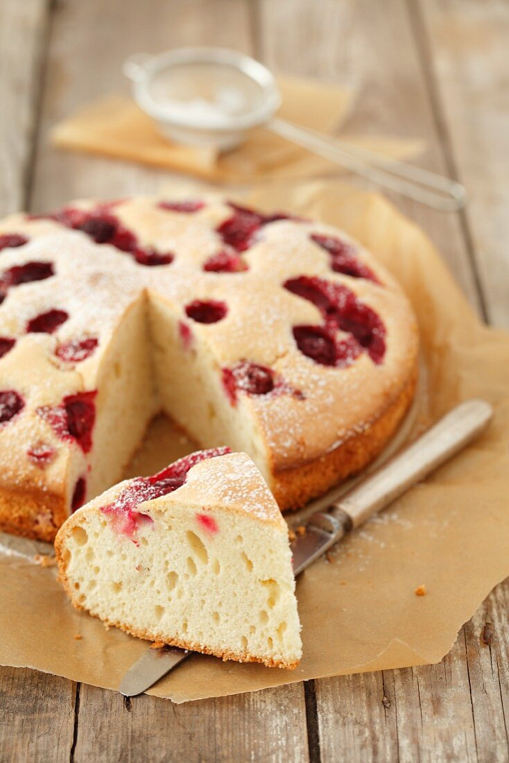 A cherry cake, sliced