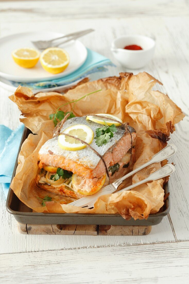Baked salmon with lemons and herbs