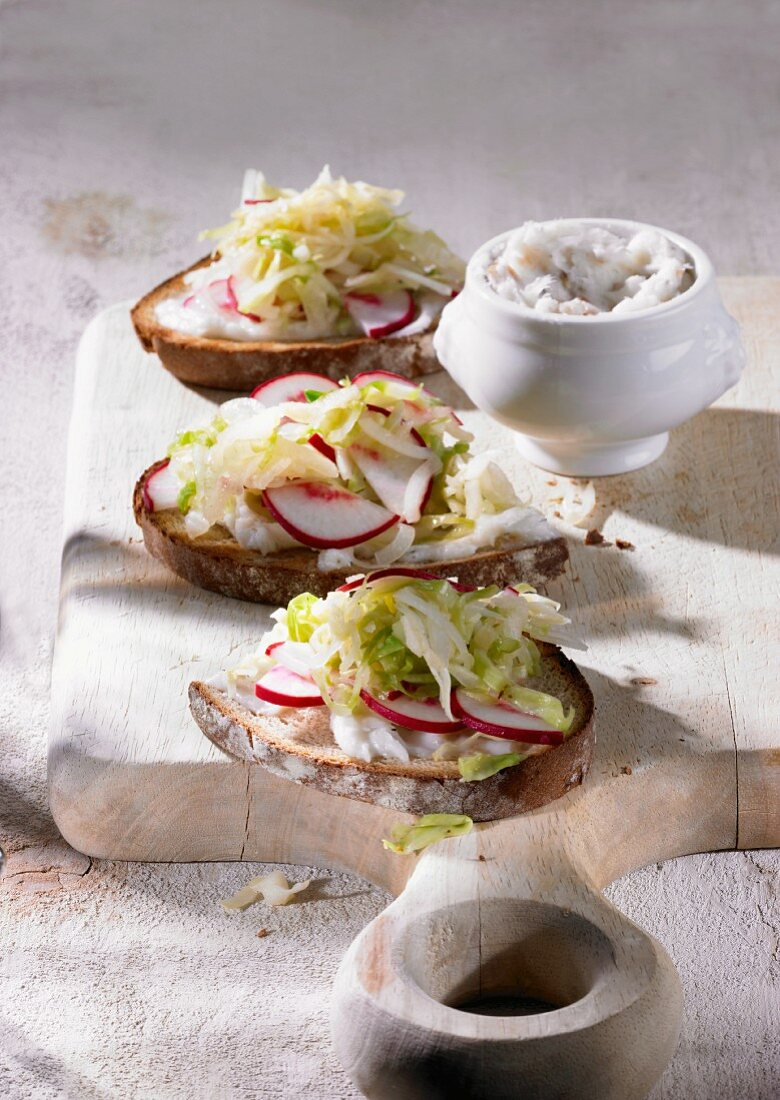 Brown bread topped with dripping and pointed cabbage salad