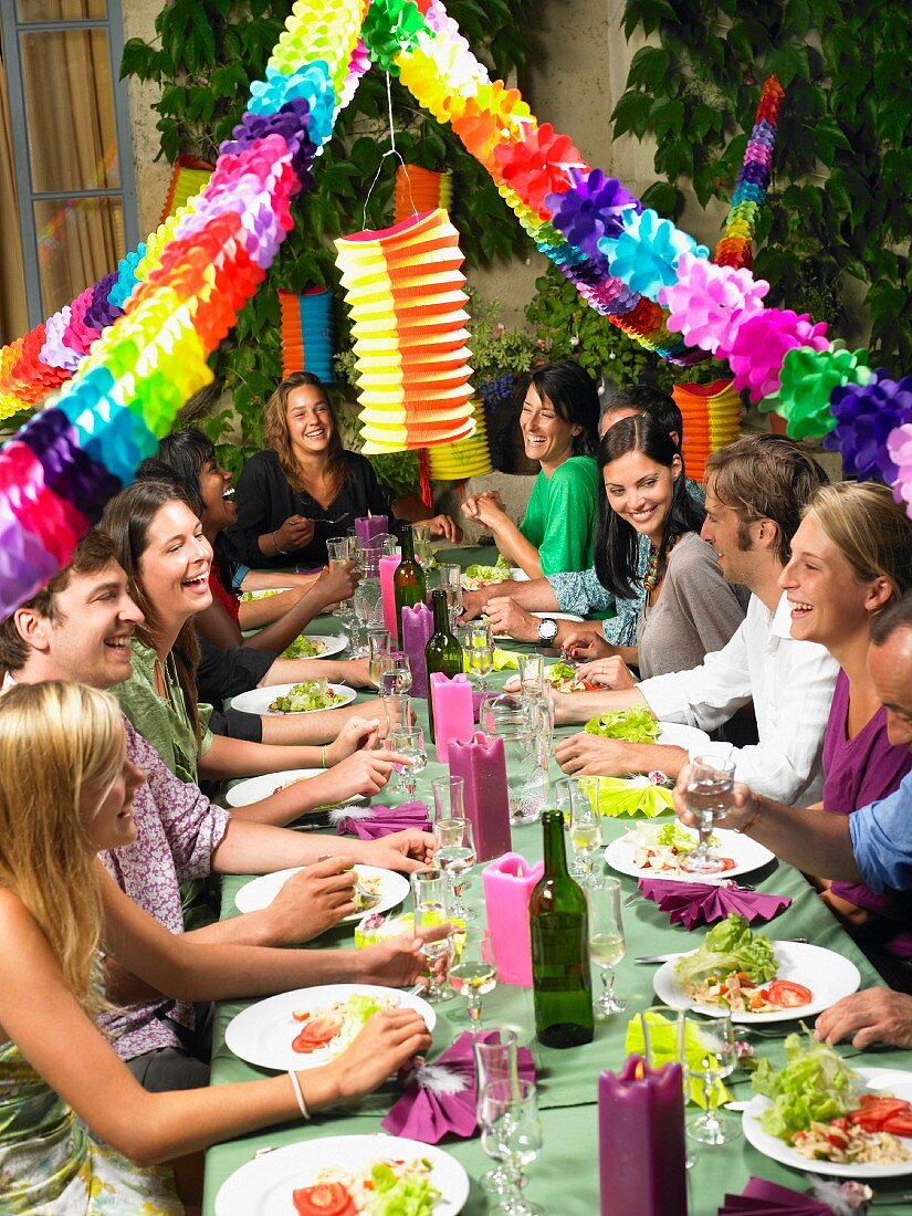 People sitting at table, celebrating