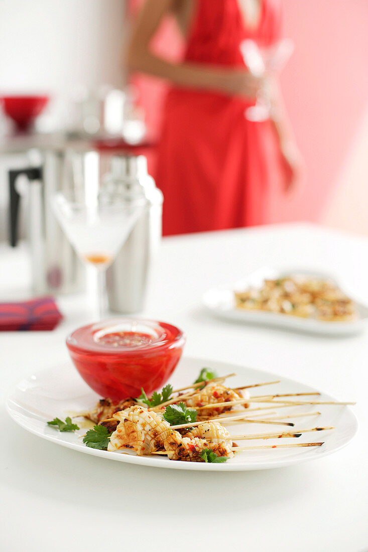 Squid skewers with chilli sauce