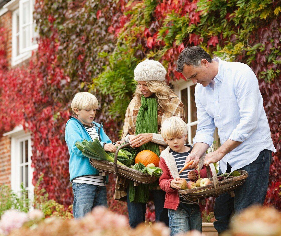 Family picking seasonal vegetables