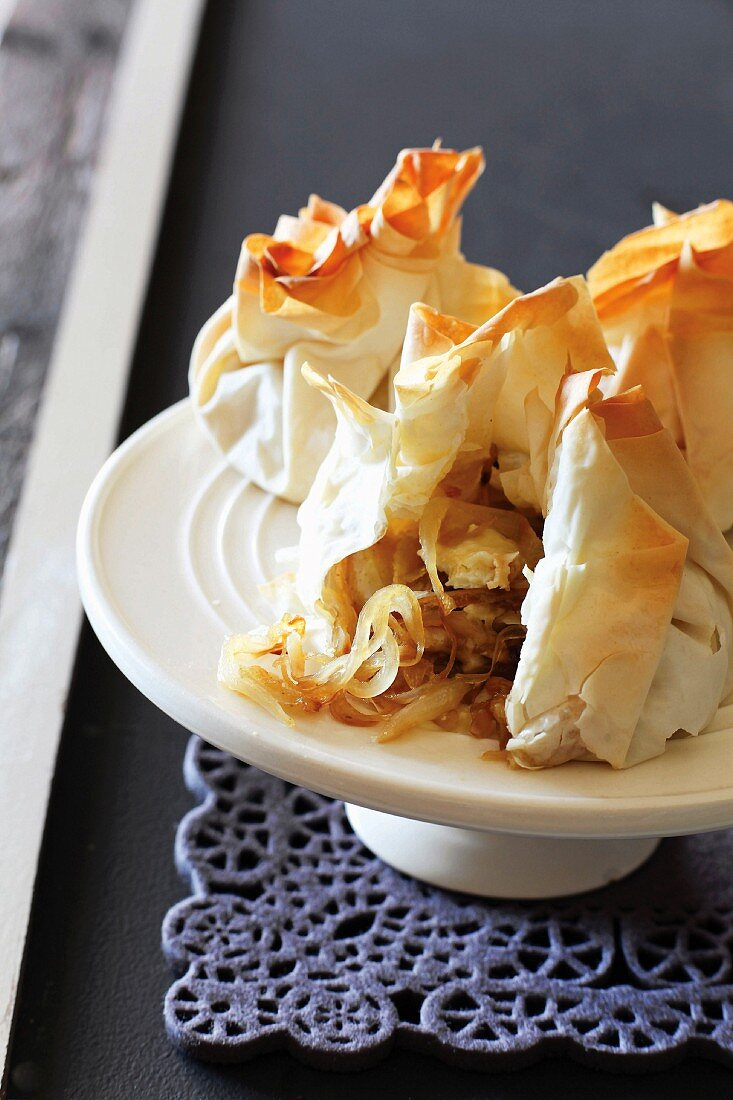 Filo pastry parcels with caramelised onions, pears and Brie
