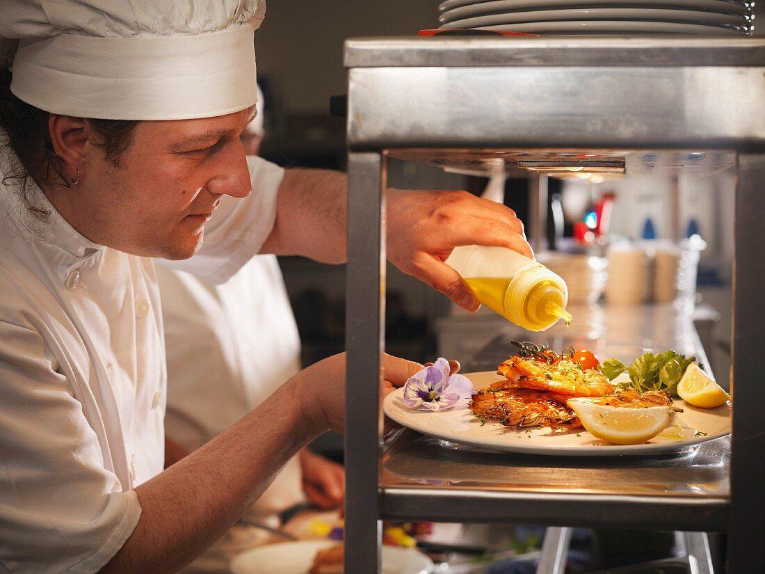 Chef preparing plate of food