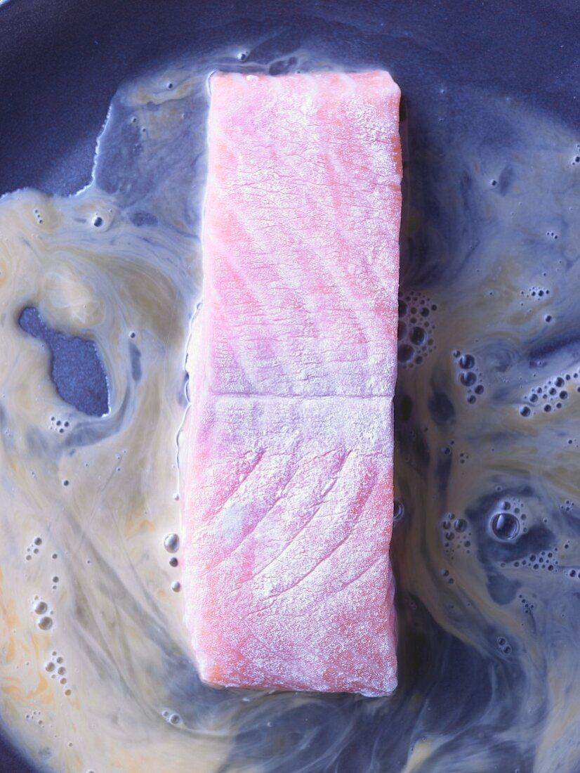 Salmon fillet being turned in beaten egg