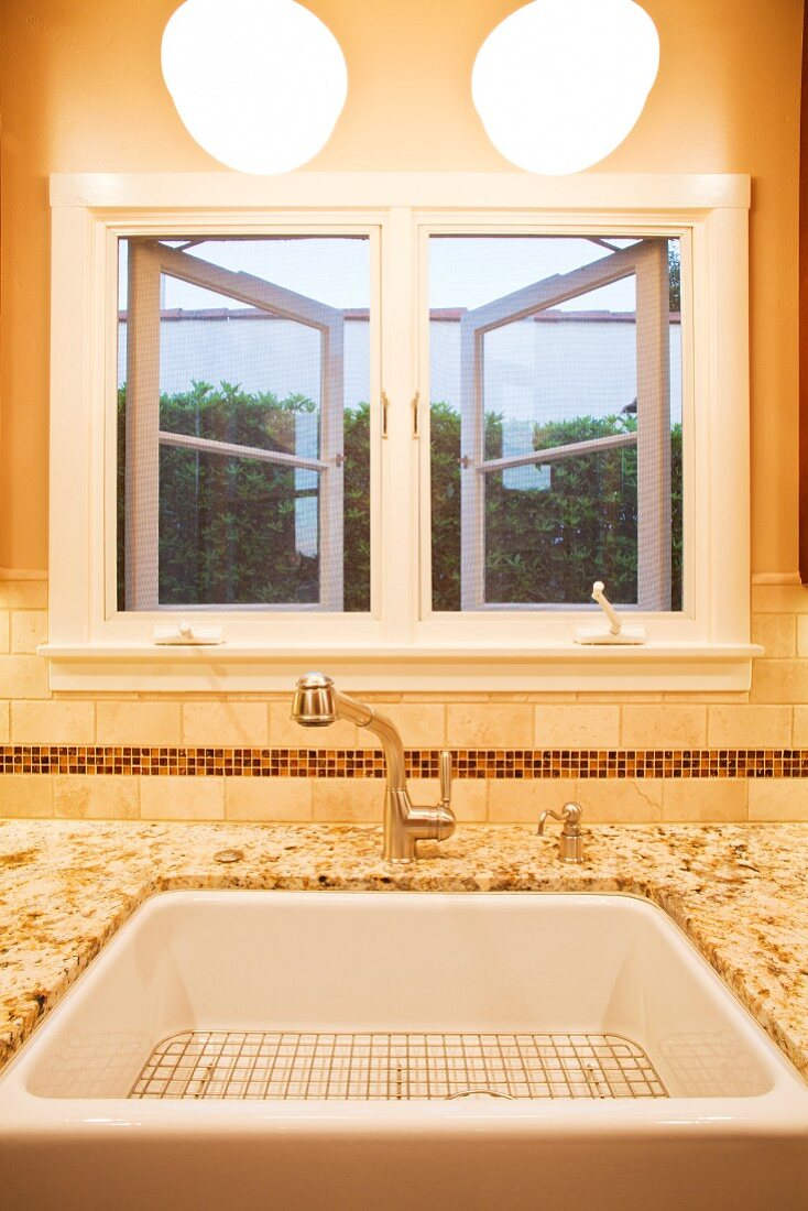 Window Above a Sink in a Renovated Kitchen