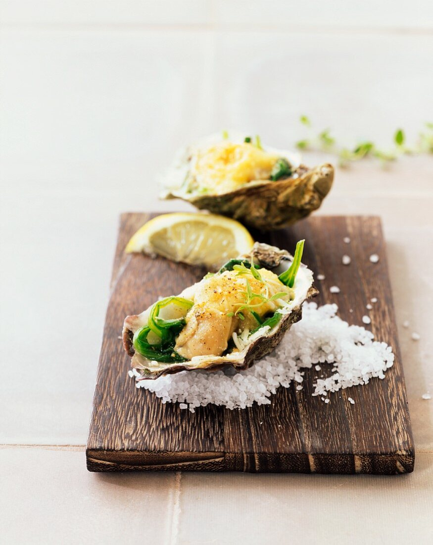 Gratinated oyster in spinach leaves
