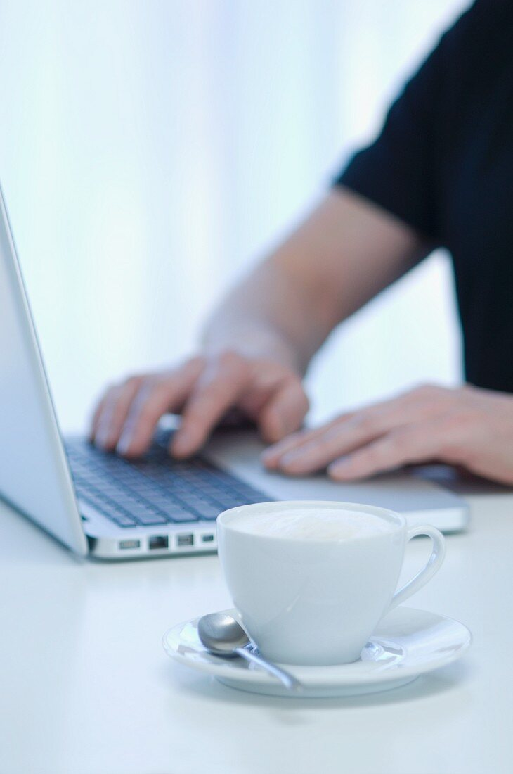 A cappuccino on a desk