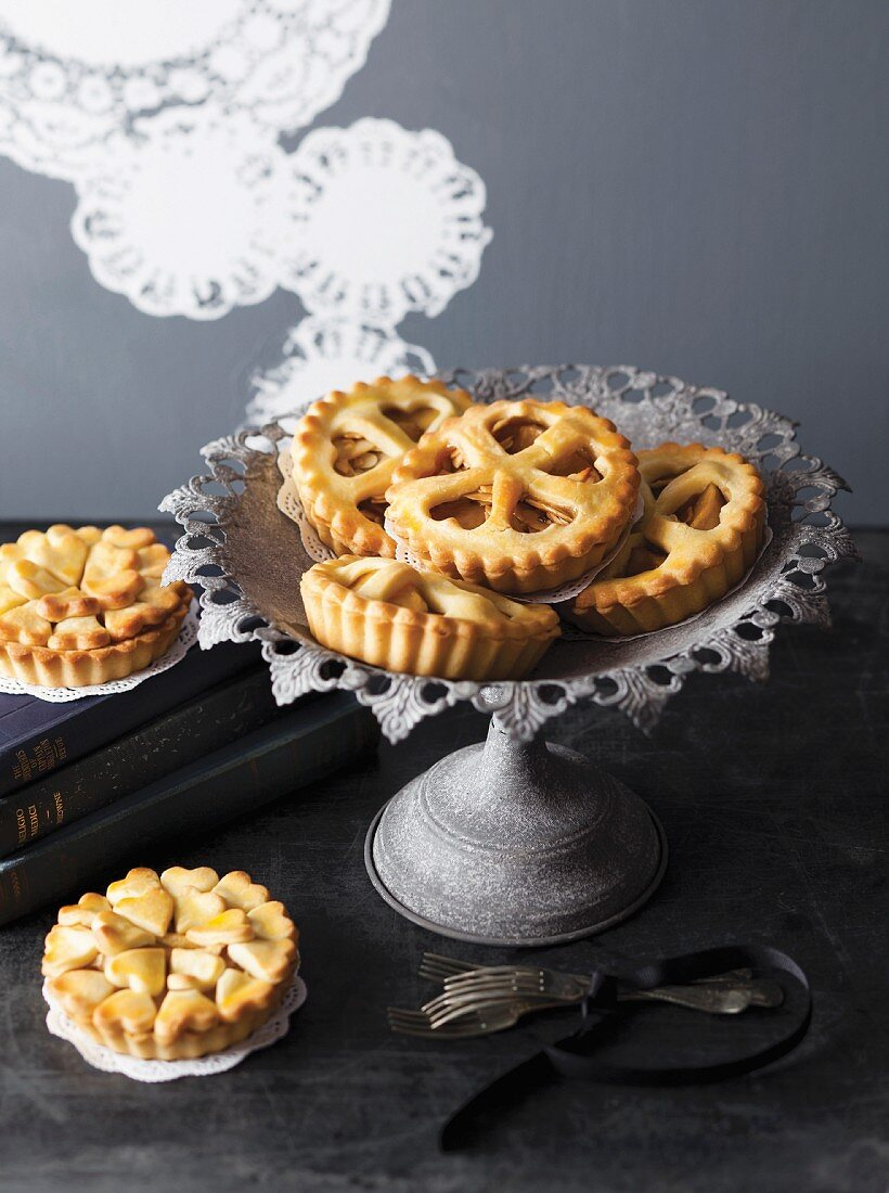 Small apple tartlets with heart-shaped decoration