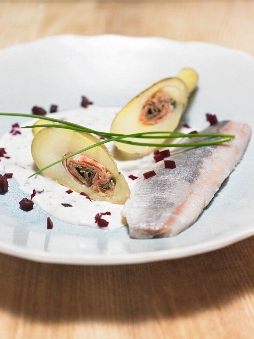 Soused herring on yogurt sauce with stuffed potatoes