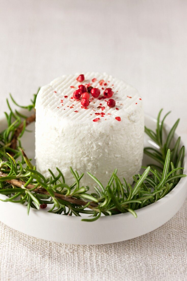 Crottin de Cavignole (French goat's cheese) with rosemary and pepper