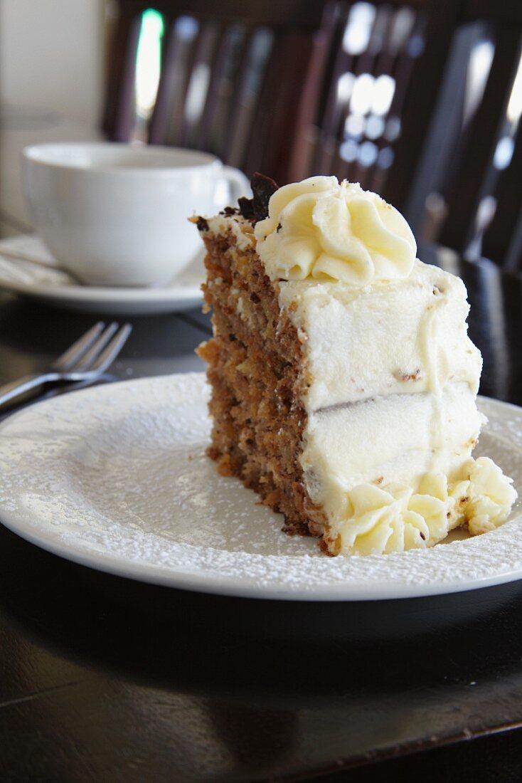 A slice of Hummingbird Cake (banana and pineapple cake, USA)