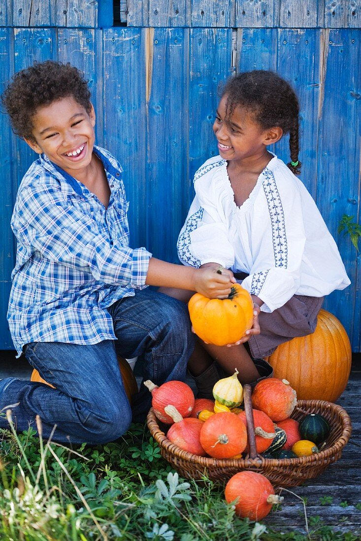 Children playing with a pumpkin