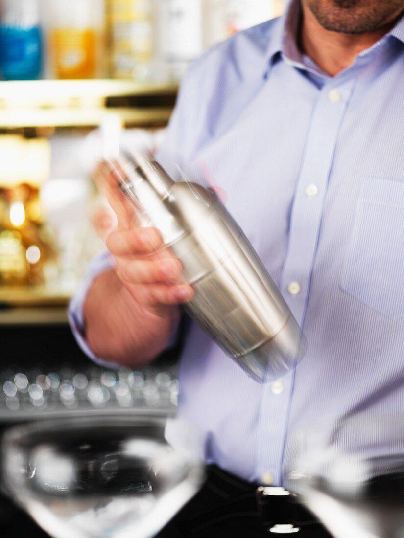 A barman mixing a Martini