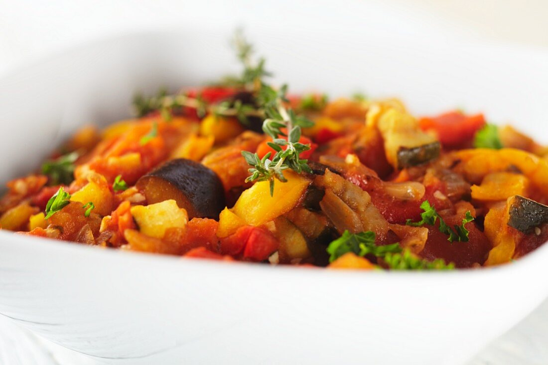 Ratatouille in a White Bowl with a Sprig of Thyme