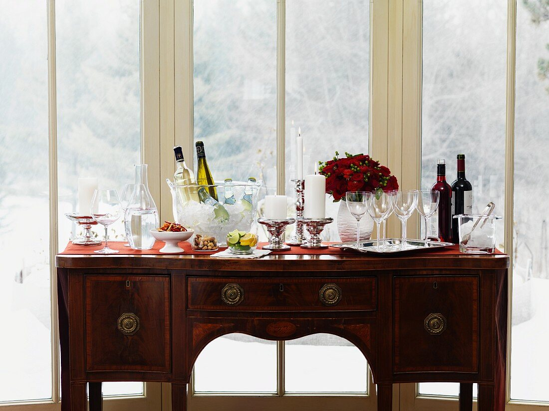 A wine buffet on an antique chest of drawers