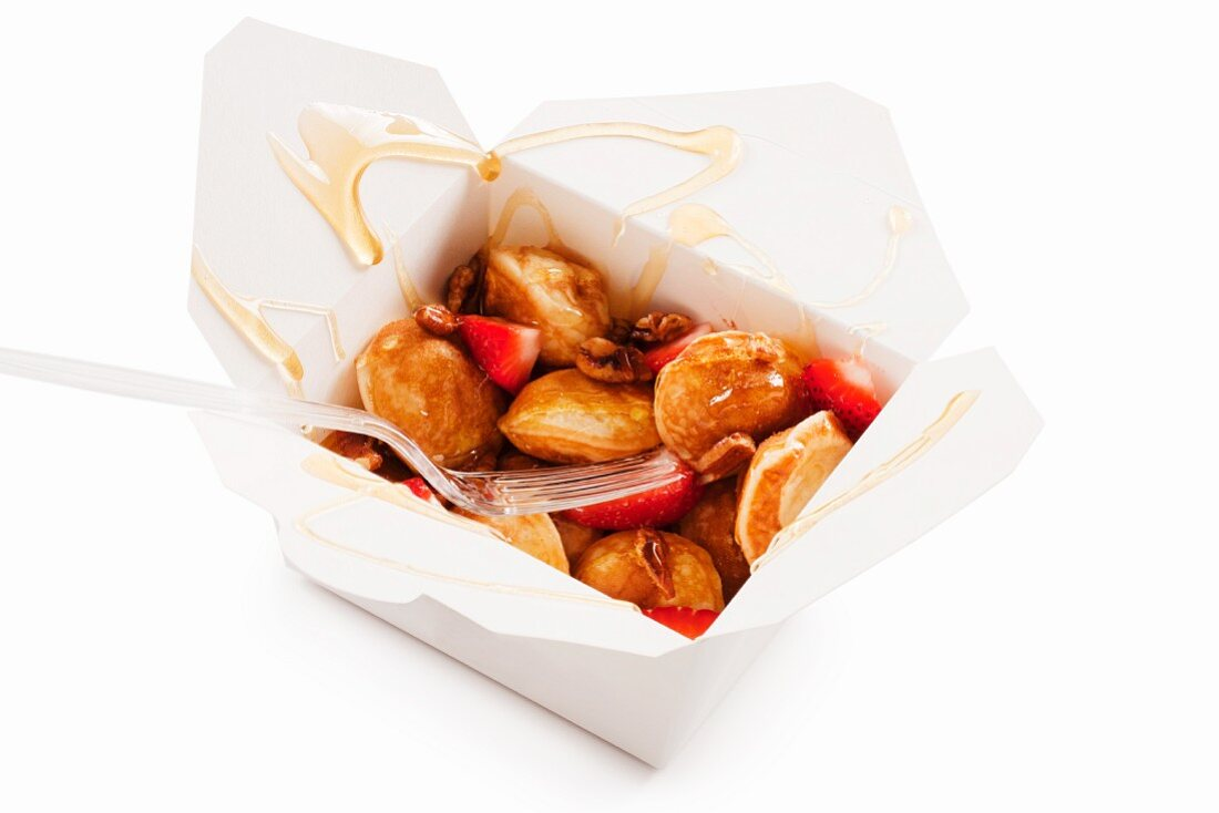 Mini Pancakes with Strawberries and Syrup in a Take Out Container