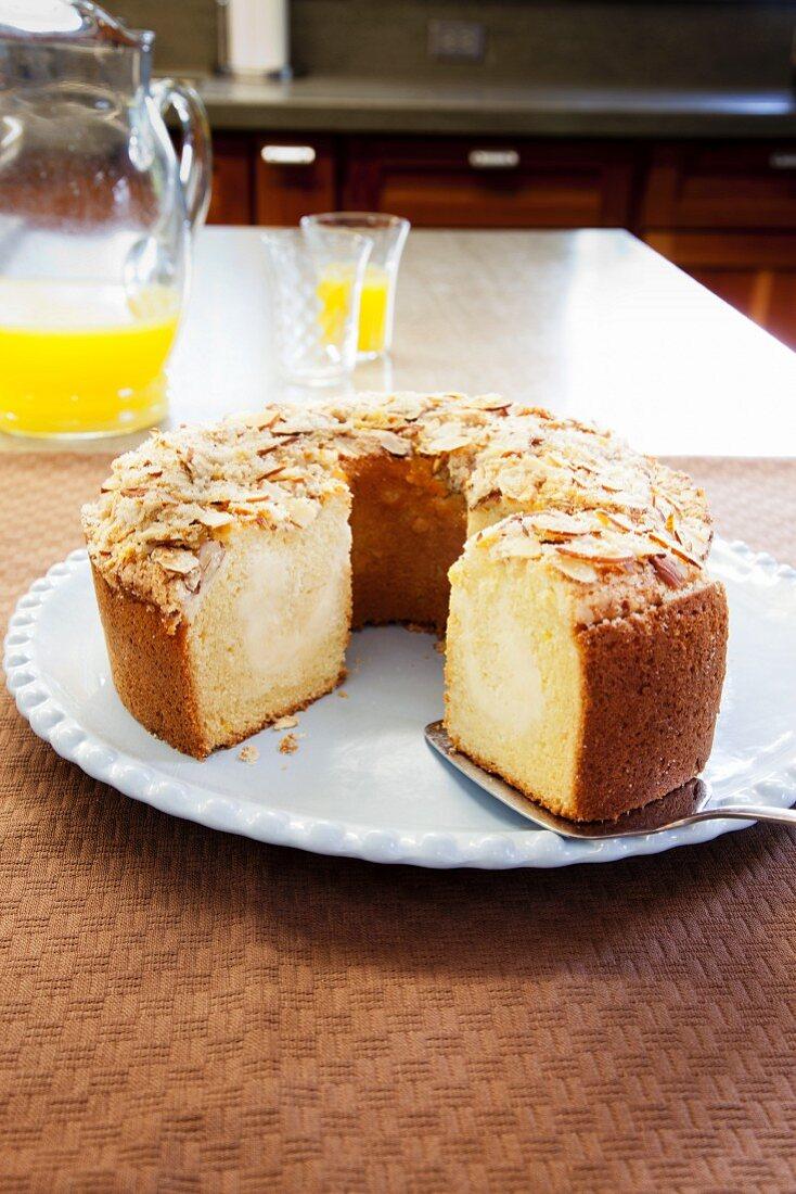Almond Coffee Cake; Slice Removed; With Cake Server