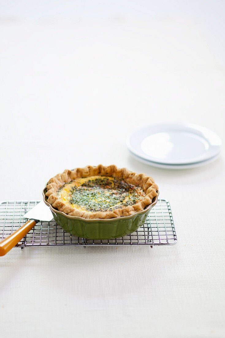 Quiche in a Baking Dish on a Cooling Rack