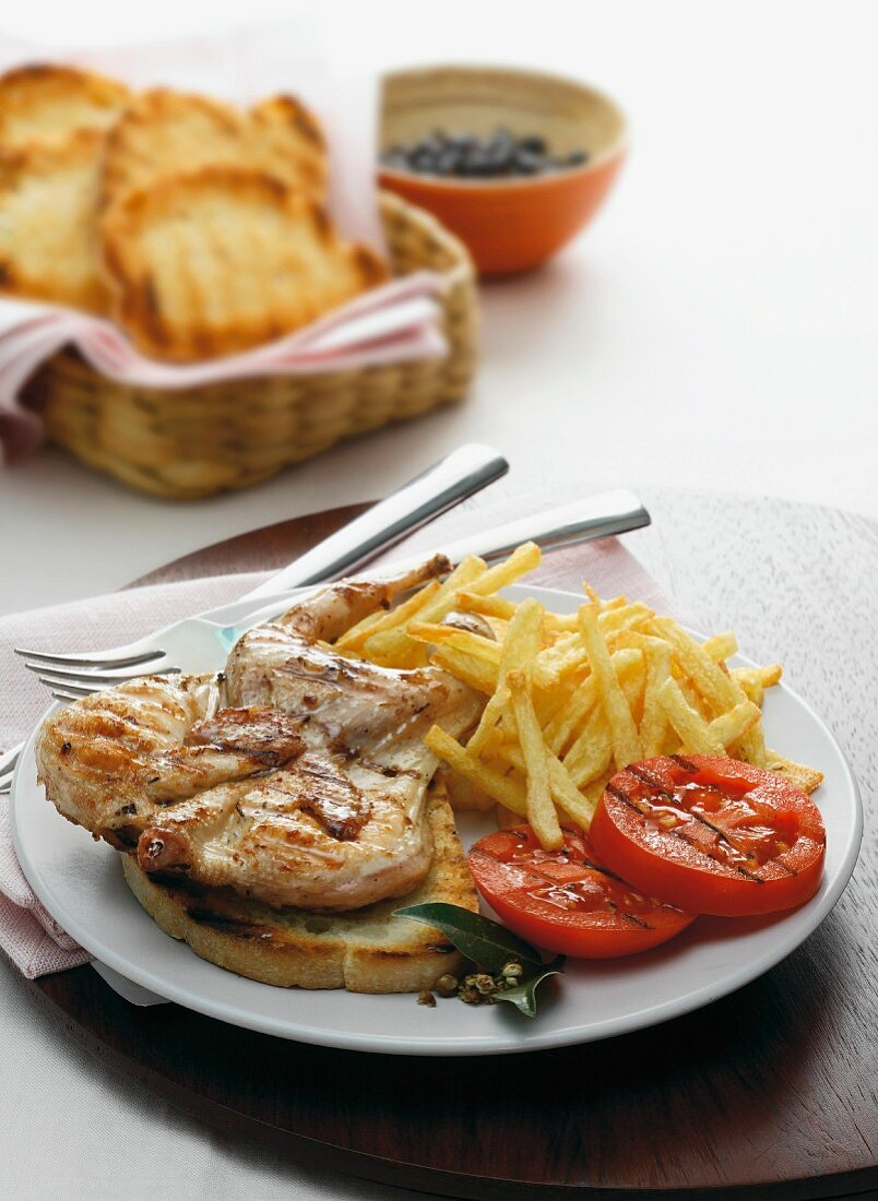 Quail in a brandy marinade on toast with chips