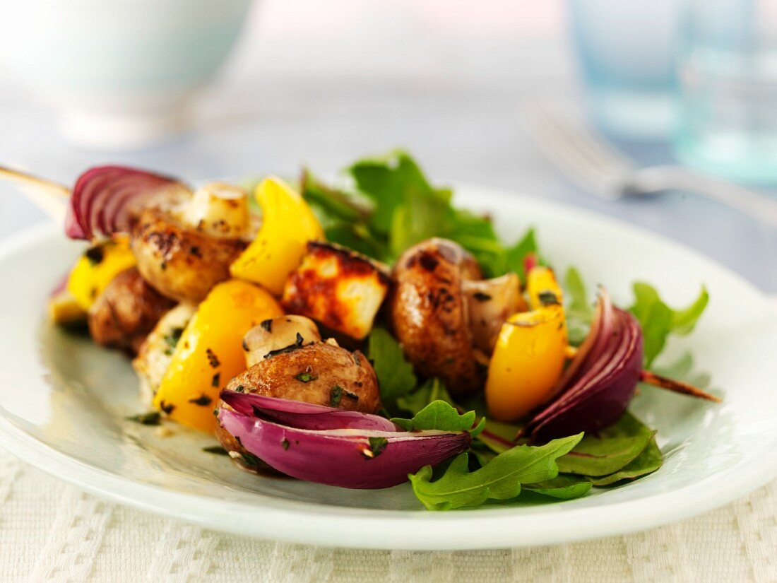 Mushroom kebabs with peppers, cheese and onions