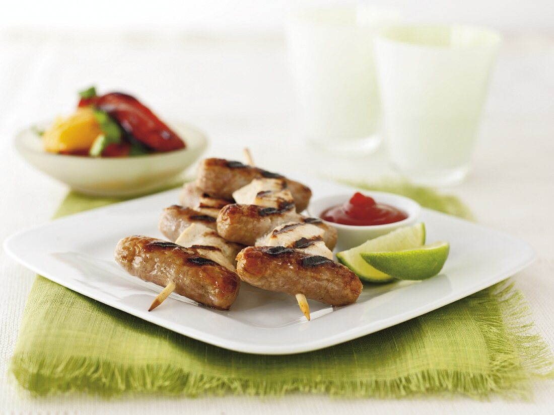 Grilled sausage and chicken kebabs
