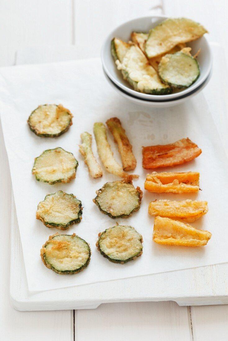 Vegetable tempura on a piece of kitchen paper
