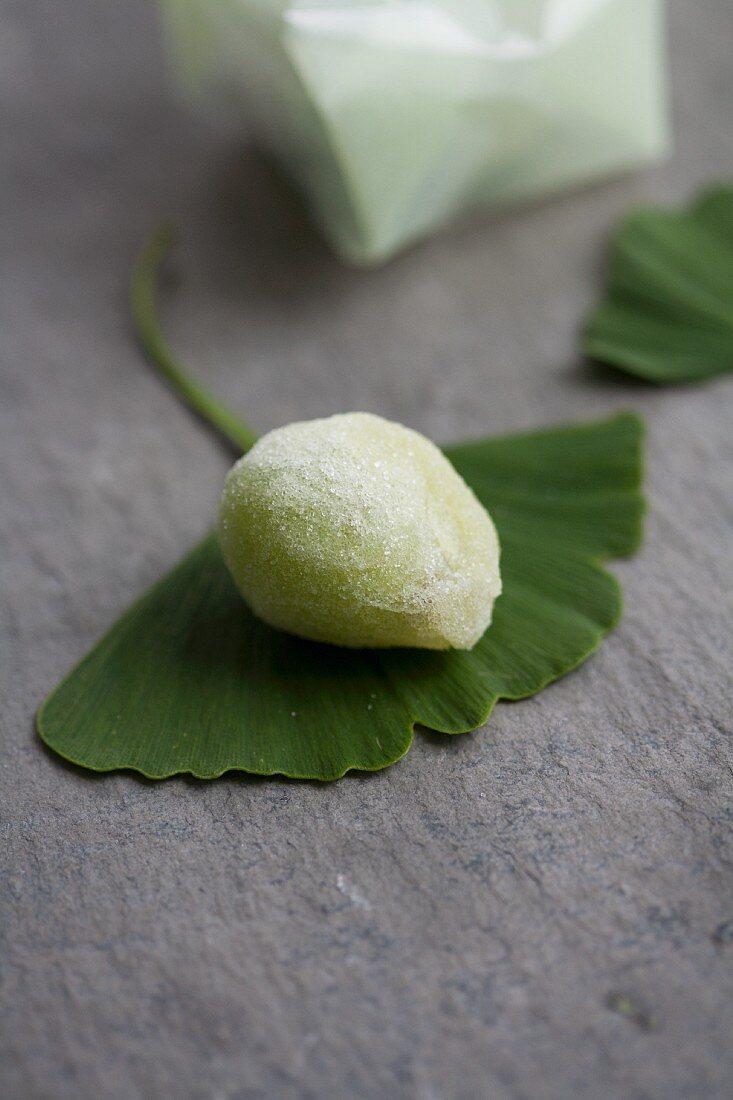 A sugared grape (Japanese sweet) on a ginkgo leaf