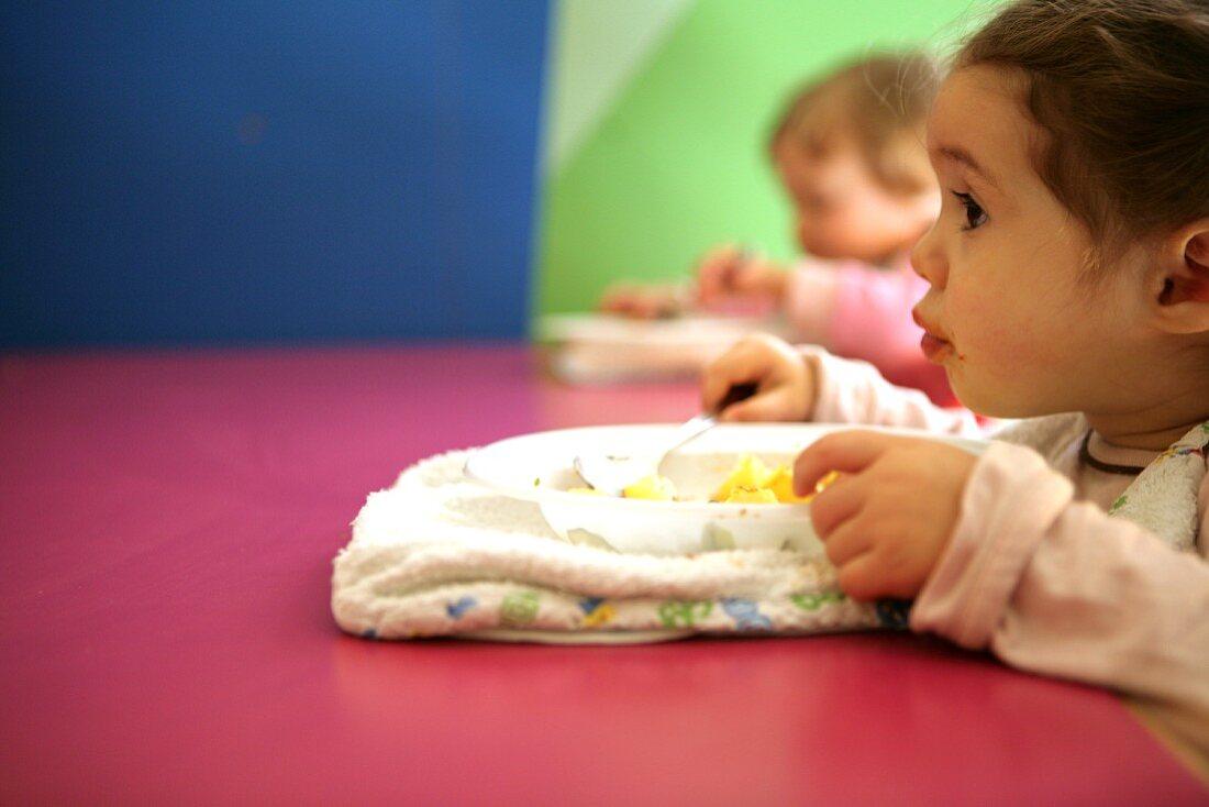 Babies having lunch