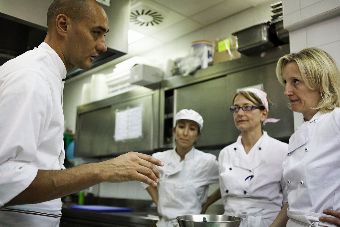 A chef giving staff instructions