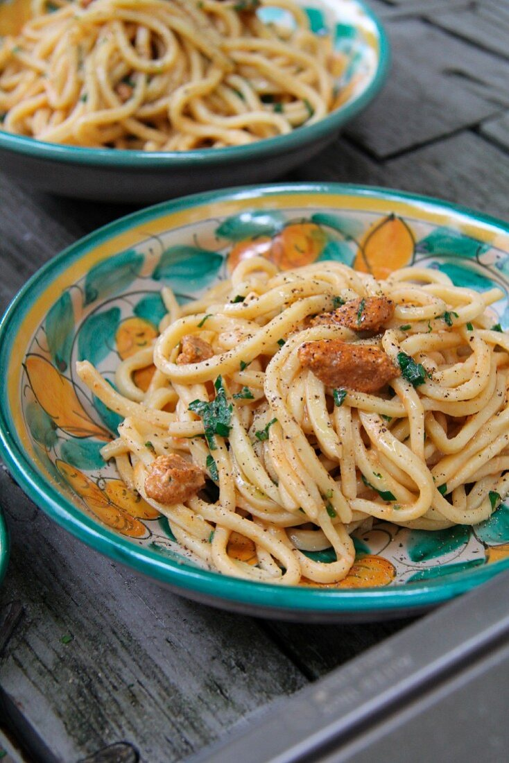 Homemade pasta with sea urchins and parsley