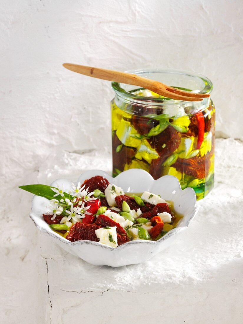 Dried tomatoes and sheep's cheese with ramsons and capers in olive oil